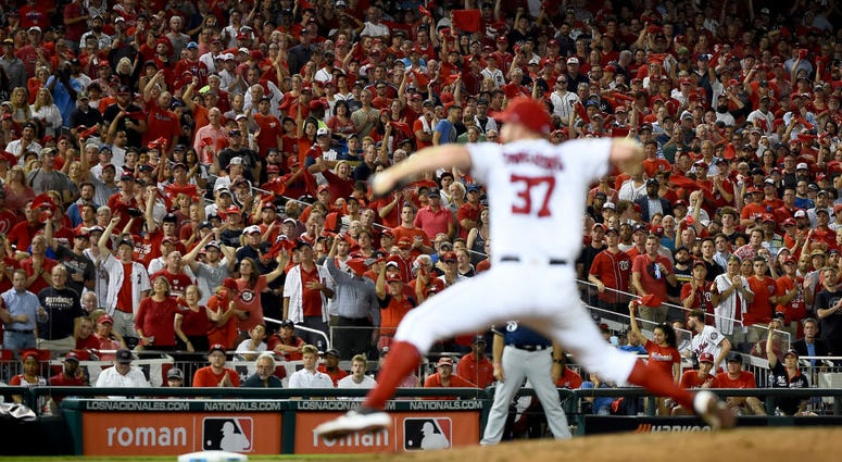 PHOTOS: Stay in the fight! Nats beat Brewers in Wild Card