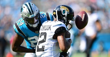James Bradberry of the Carolina Panthers breaks up a pass intended for Dede Westbrook of the Jacksonville Jaguars.