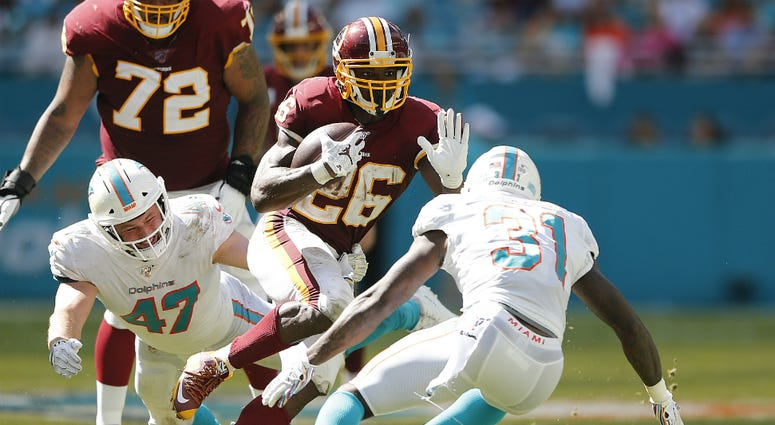 Redskins get first win against dreadful Dolphins