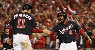 Ryan Zimmerman celebrates scoring with Howie Kendrick of the Washington Nationals in the first inning against the St. Louis Cardinals.