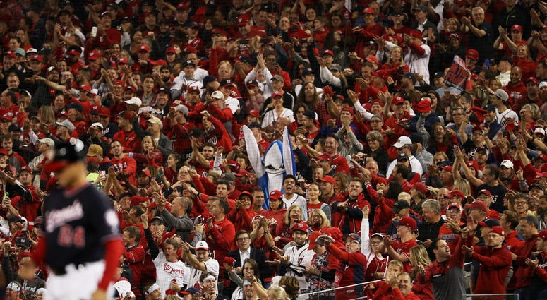 A fan dressed as a shark cheers as Gerardo Parra in the NLCS.
