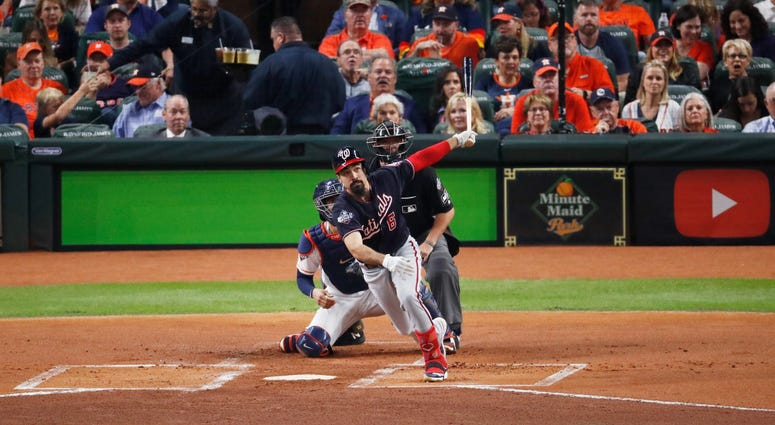 Anthony Rendon hits a two-run double in Game 2 of the World Series.