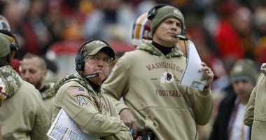 Head coach Bill Callahan and offensive coordinator Kevin O'Connell of the Washington Redskins react to a play.