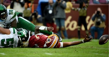 Redskins QB Dwayne Haskins is sacked by Frankie Luvu of the New York Jets.