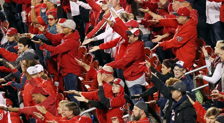 Fans take part in the Baby Shark song as Gerardo Parra (not pictured) of the Washington Nationals comes up at bat against the Houston Astros during the sixth inning in Game 3.