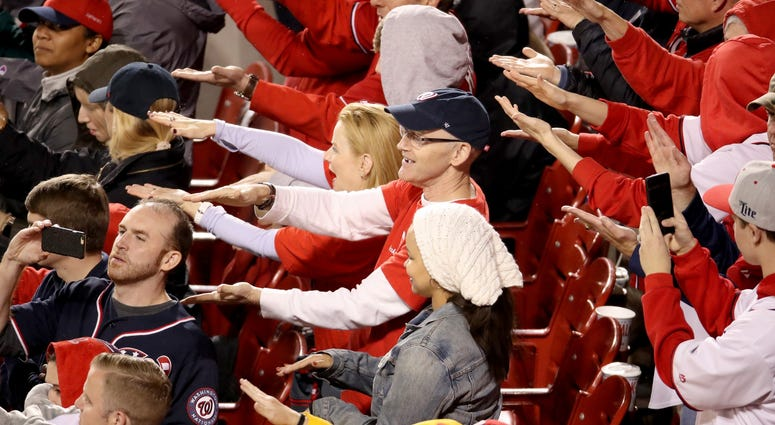 Fans cheer for Gerardo Parra of the Washington Nationals during the sixth inning in Game Four of the 2019 World Series.