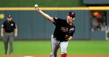 Nationals pitcher Stephen Strasburg delivers the pitch against the Houston Astros during the World Series.