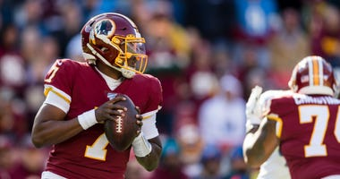 Redskins QB Dwayne Haskins looks to pass against the Detroit Lions during the first half.