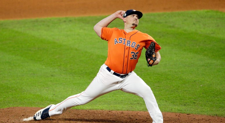 Will Harris of the Houston Astros delivers the pitch against the Washington Nationals during the seventh inning in Game 7.