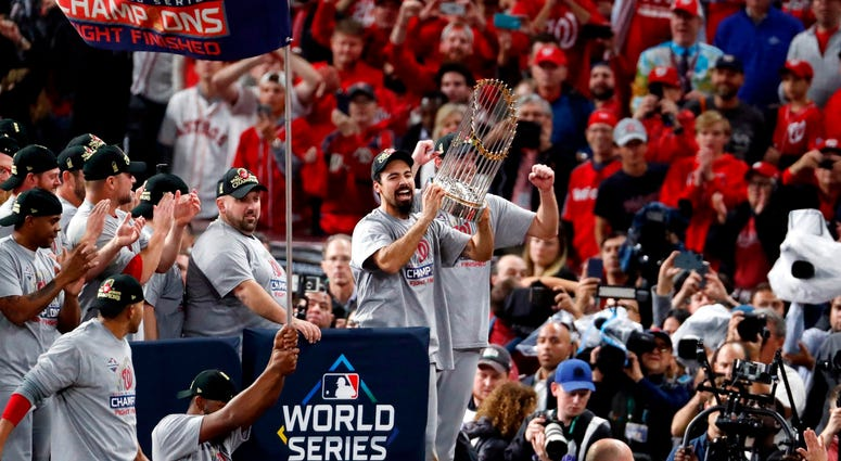 Anthony Rendon hoists the World Series trophy with the Washington Nationals.