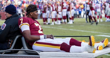 Redskins quarterback Dwayne Haskins is carted off the field after an injury during the second half.