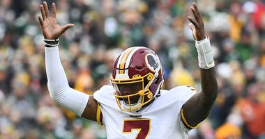 Redskins quarterback Dwayne Haskins celebrates a touchdown in the second quarter.