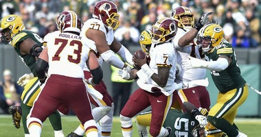 Redskins QB Dwayne Haskins looks to avoid a sack against the Green Bay Packers.