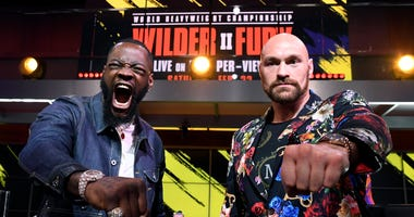 Deontay Wilder and Tyson Fury face off during a news conference at Fox Studios.