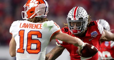 Ohio State's Chase Young pursues Clemson QB Trevor Lawrence in the first half during the College Football Playoff Semifinal.