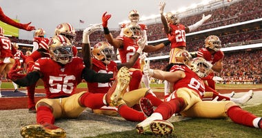 San Francisco 49ers defense celebrates an interception during the NFC Championship game.