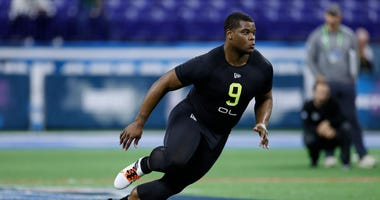Redskins draft Saahdiq Charles to replace Trent Williams.