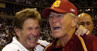 Joe Gibbs and Joe Bugel embrace after the Redskins beat the Cowboys in 2005.