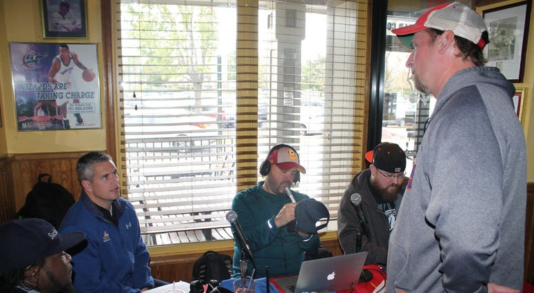 JP and Cakes from The Sports Junkies as well as 106.7 The Fan Street Team, chats with Skins fans at Glory Days Grill in Centreville, Va before kickoff.