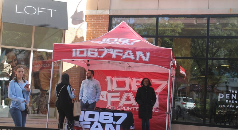 Danny Rouhier and 106.7 The Fan Street Team interacted with listeners at South Moon Under in Arlington, Virginia.