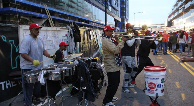 Performers entertain baseball fans before Game 4 of the World Series outside Nationals Park.