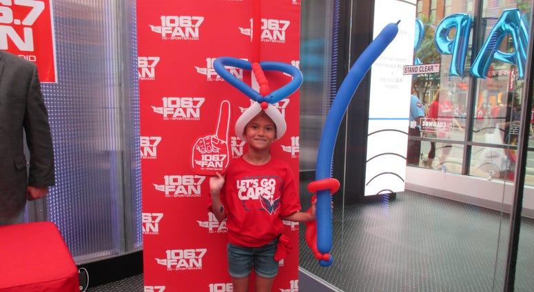 Fan stop by Studio Xfinity before the Hockey Finals