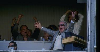 Washington Redskins owner Jack Kent Cooke celebrates during a game against the Dallas Cowboys at RFK Stadium in Washington, D. C. The Redskins won the game, 19-15.