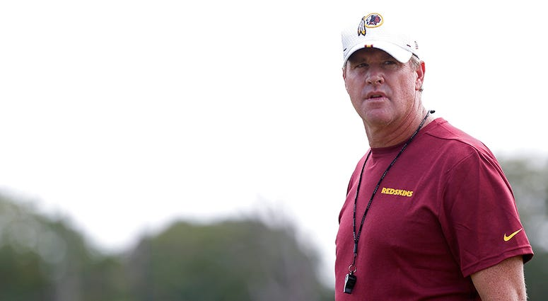 Jay Gruden on the field at Redskins Training Camp.