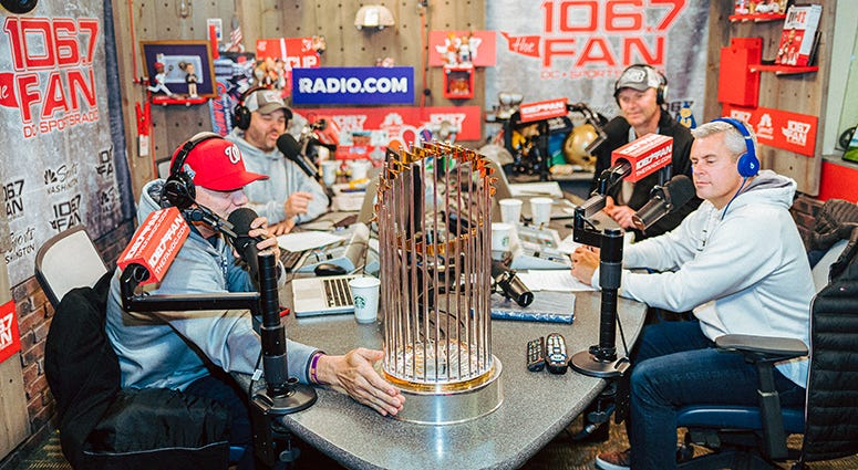 The Junkies hanging with the World Series Trophy