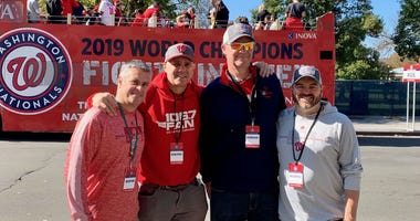 The Sports Junkies of WJFK-FM take part in the Washington Nationals victory parade in Washington, D.C. on Saturday, November 1.