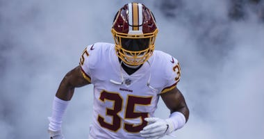 Redskins safety Montae Nicholson runs through the tunnel.