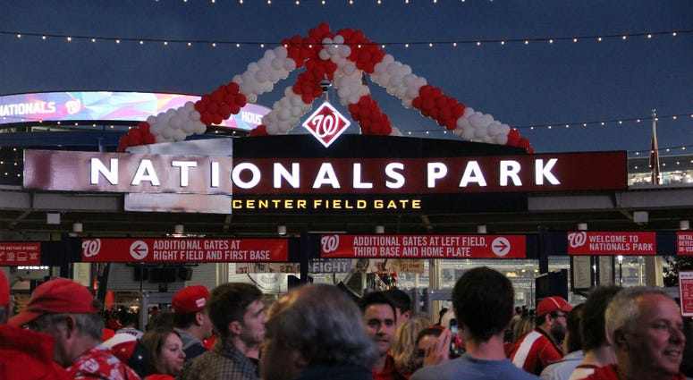 Baseball fans enter Nationals Park for World Series Game 4 between the Astros and Nats.