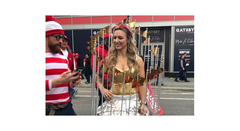 A woman dubbed, Mrs. World Series, dresses up as the Commissioner's Trophy before Game 4 at Nationals Park.