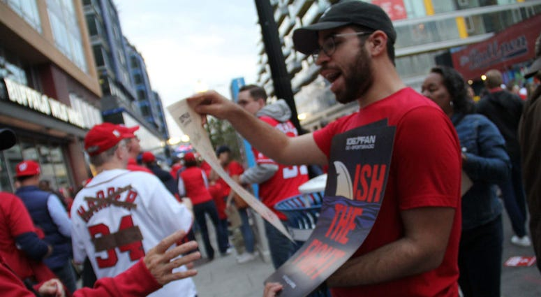 """Finish the Fight"" cards were handed out to baseball fans ahead of Game 3 of the World Series in D.C."