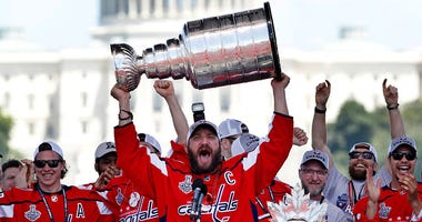 Alex Ovechkin holding the Stanley Cup