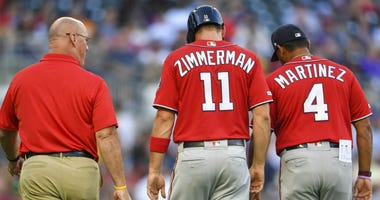 Nationals 1B Ryan Zimmerman walks off the field with an injury.