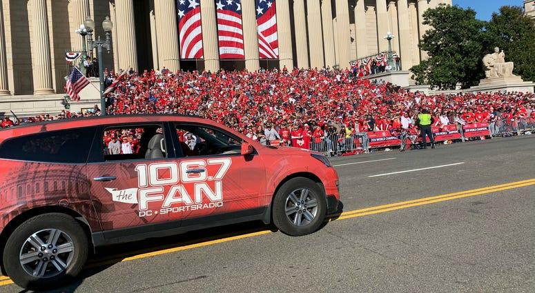 A 106.7 The Fan station vehicle drives through the Washington Nationals parade on Saturday, November 1.