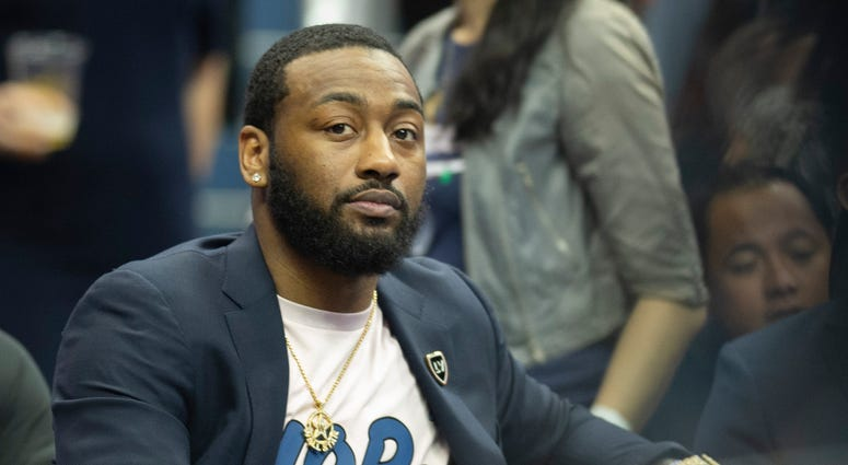 Wizards guard John Wall is seen without brace, but walking with slight limp months after surgery.