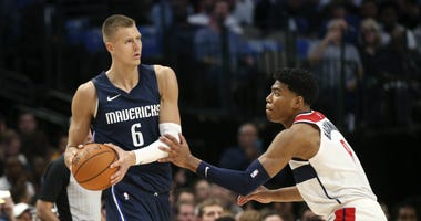 Dallas Mavericks forward Kristaps Porzingis looks to shoot as Washington Wizards forward Rui Hachimura defends.