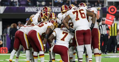 Washington Redskins quarterback Dwayne Haskins in the huddle against the Vikings.