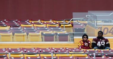 Redskins fans watch from the stands against the New York Jets
