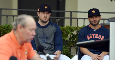 Houston Astros' Jose Altuve and Alex Bregman watch owner Jim Crane.