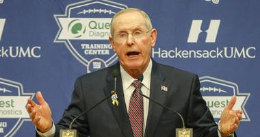 New York Giants former head coach Tom Coughlin addresses the media.