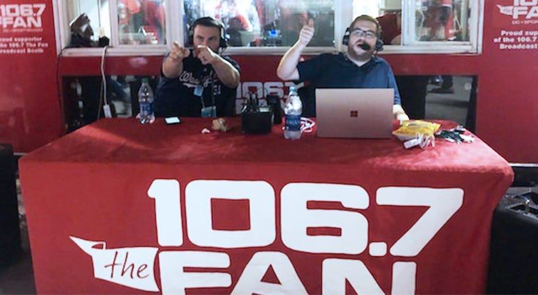 Danny Rouhier (L) and Grant Paulsen (R) of 106.7 The Fan broadcasting live before Nationals-Astros Game 5 at Nats Park.