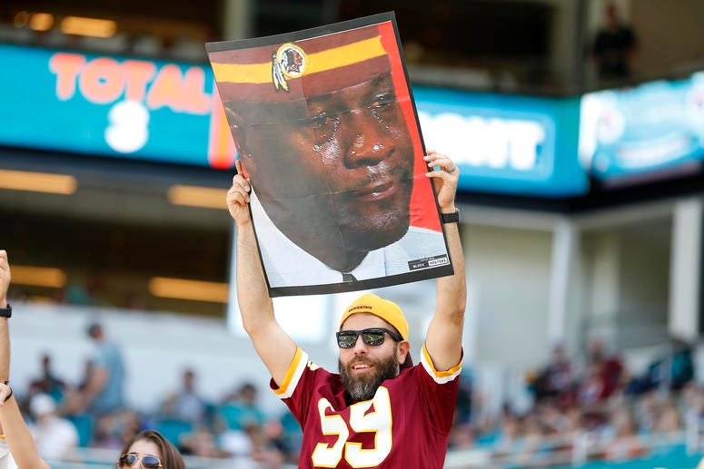 Redskins fans hide faces, protest Bruce Allen in Miami