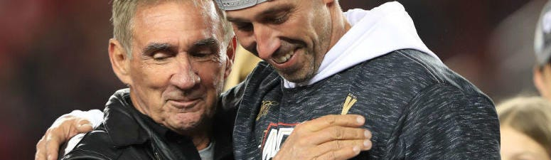 Head coach Kyle Shanahan of the San Francisco 49ers celebrates with his father, Mike Shanahan, after winning the NFC Championship game.