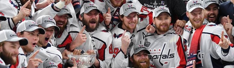 Washington Capitals players pose for a team photo with the Stanley Cup