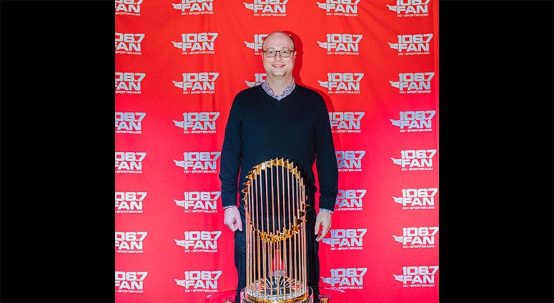 106.7 The Fan Program Director Chris Kinard poses with the World Series trophy