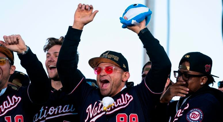 Gerardo Parra of the Washington Nationals cheers during a parade to celebrate the Washington Nationals World Series victory.
