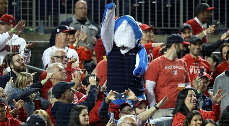 A fan in a shark costume Fans takes part in the Baby Shark song as Gerardo Parra bats.